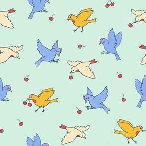 Birds catching cherries