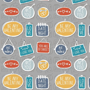 colorful love labels on gray