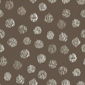 animal print polka dots on mud brown