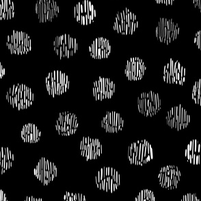 Polka dot animal print leopard spots on black