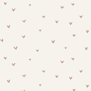 Sienna hearts on bone background