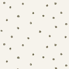 Dark khaki dots on bone