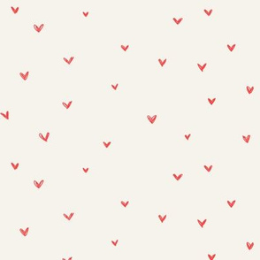 Hot red hearts on bone background