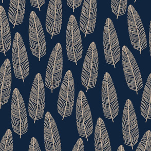 Beige tropical leaves on dark green background