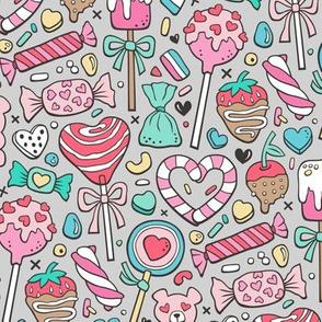 Valentine's Day Treats Candy & Hearts on Light Grey