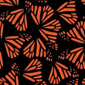 Orange Butterfly Wings on Black