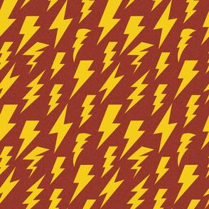 yellow lightning bolt on red linen