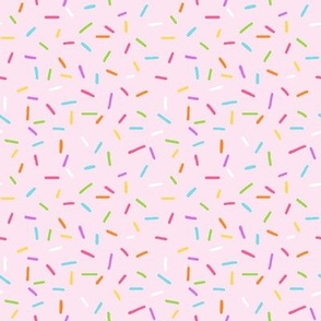 Rainbow Sprinkles on pale pink - larger scale