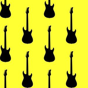 Large Black Electric Guitars on Yellow