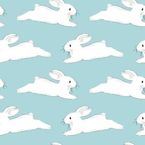 Leaping White Bunnies on Blue