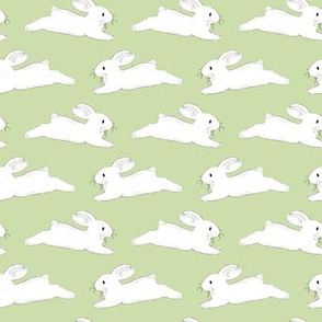Leaping White Bunnies on Green