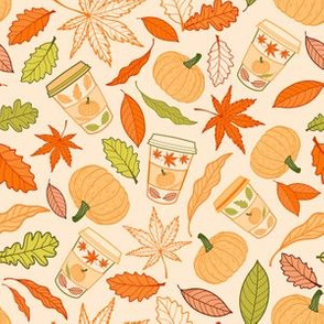 Autumn leaves, pumpkins and coffee cups