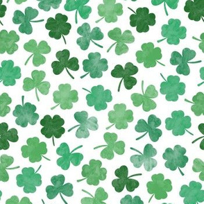 green watercolor clovers on white