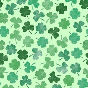 green watercolor clovers on green