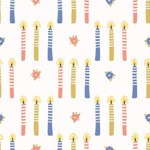Hand drawn lit candles in blue, pink, yellow.
