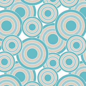 concentric circles in turquoise, sand and white