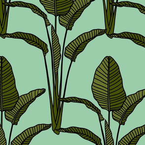 Banana leaves on seafoam