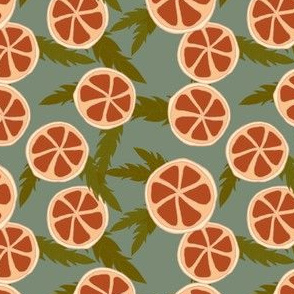 clementine slices on dusty green