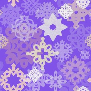Paper snowflakes and stars on violet background