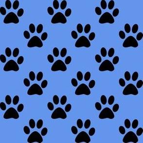 One Inch Black Paw Prints on Cornflower Blue