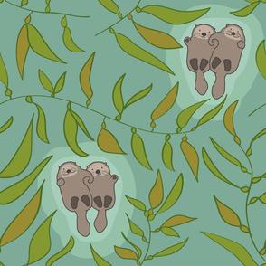 otters swimming in kelp
