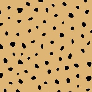 Little spots and speckles panther animal skin abstract minimal dots in mustard yellow