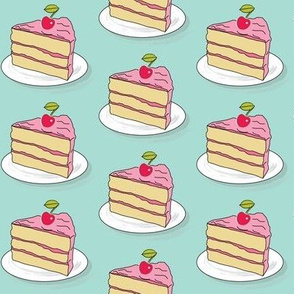 cake slice with a cherry on top on teal