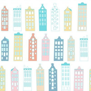 Cute pastel colored little houses baby nursery design in pink, blue, yellow and white