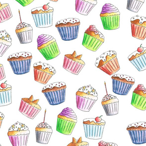 Delicious Colorful cupcakes on a solid white background