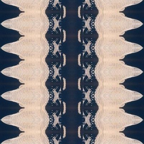 Creamy shapes with a crispy texture, dark blue background