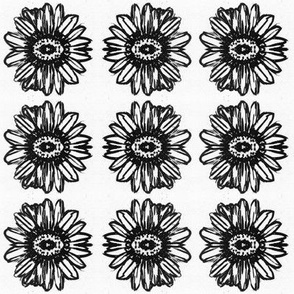 Black and white sunflower emblem, large