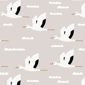 Birds and clouds in the sky Scandinavian crane and stork design gender neutral beige rust