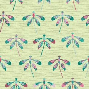 Spring folk dragonflies on green droplets