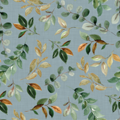 magnolia leaves and branches on blue linen