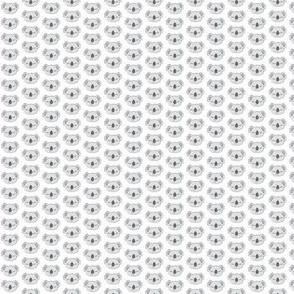 tiny symmetrical koalas on white