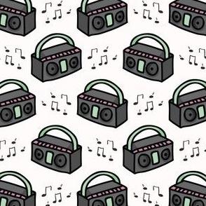Cute retro boombox cartoon seamless pattern.