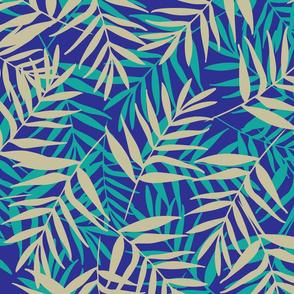 Tropical leaves on dark blue background