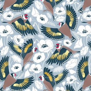 Goldfinches flying over white poppies //  small scale // blue grey background