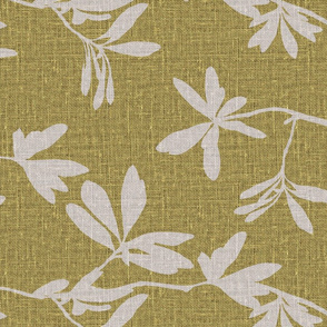 Natural leaves on chartreuse coloured linen