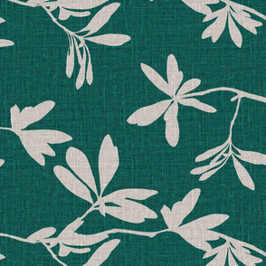 Natural leaves on emerald green coloured linen