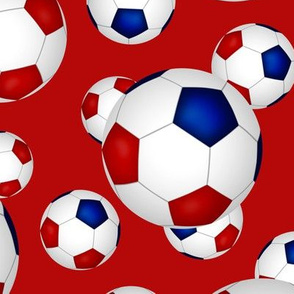 Red white and blue soccer balls on red - large