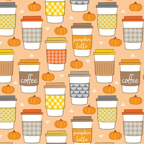 large coffee cups with sleeves and pumpkins