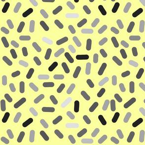 Ticker Tape - greyscale on yellow