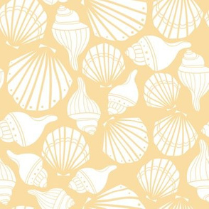 White seashells on yellow