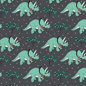 Christmas Triceratops winter wonderland jurassic park theme with dinosaurs and scarfs