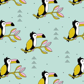 Sweet little toucan branch leaves and birds yellow pink