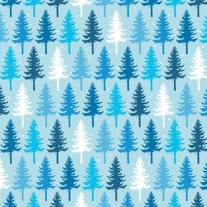 Snow Covered Trees on Blue