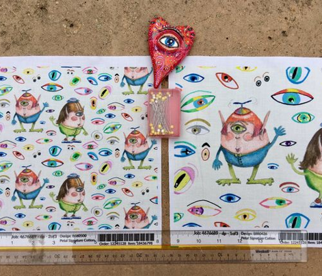 two quirky cute roly poly cyclops and some eyes, small scale, off-white cream soft-white natural
