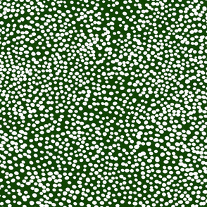 White dots on forest green