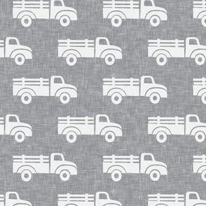 trucks on grey - LAD19